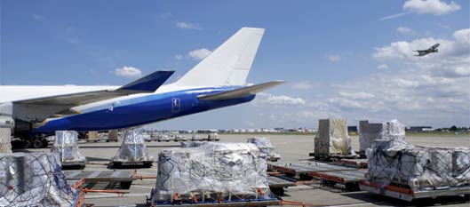 Cargo being loaded onto airplane image